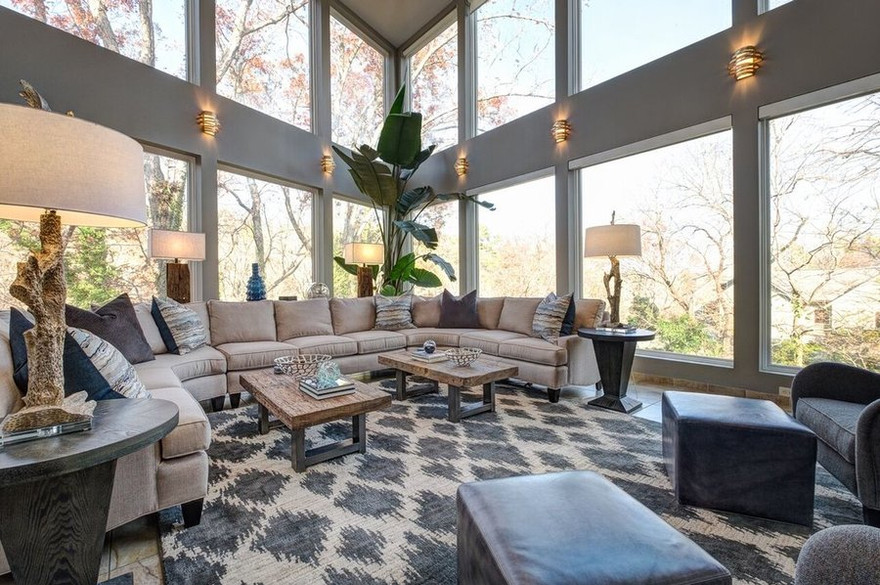 This fabulous space is ready to come enjoy the views.  Two coffee tables provide easy movement around this over sized sectional.