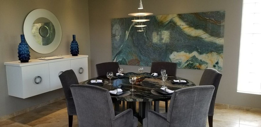 This natural slab of stone is the art and color in this sophisticated dining room.
