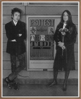 1964 [Bob Dylan and Joan Baez flanking a Seymour Chwast poster]