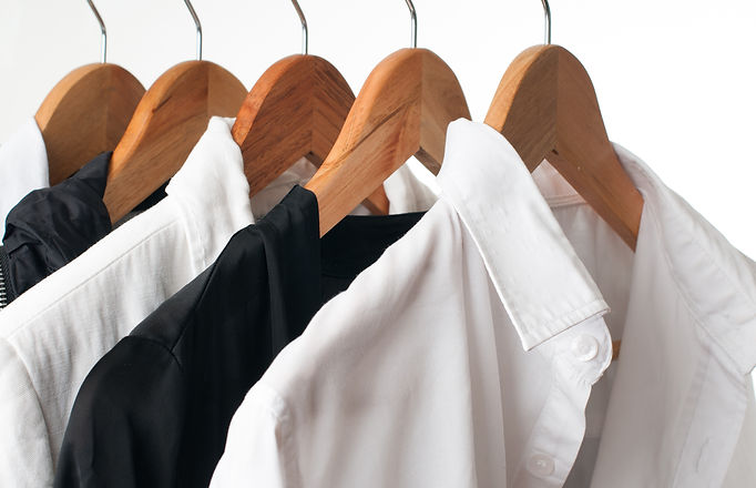 Black and white clothes hanging on a rac