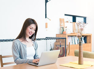 Woman working at home with a personal computer.jpg