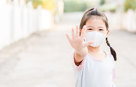 Coronavirus Covid-19.Stay at home Stay safe concept.Little chinese girl wearing mask for p