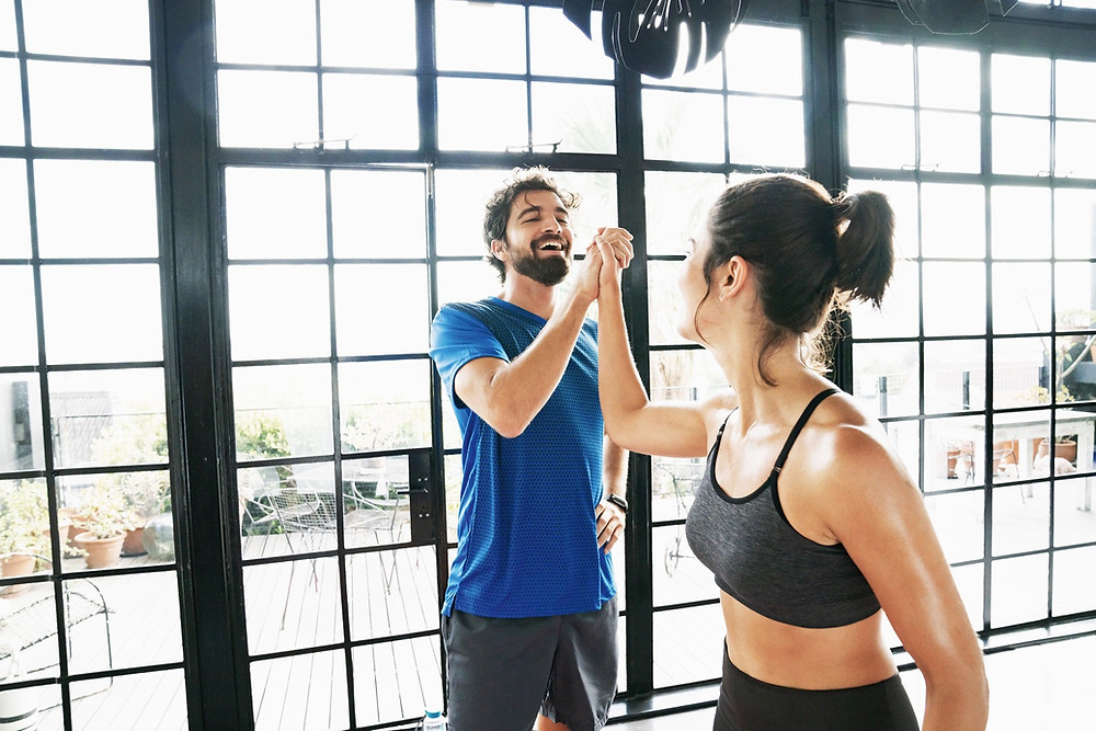 High-five after workout. Friends motivating each other. Healthy motivation.