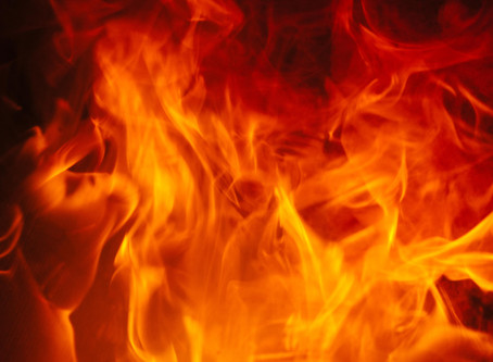 FIRE SCORCHES STRUCTURES AND VEHICLES
