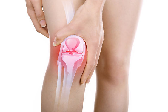 Young woman with knee pain isolated on w