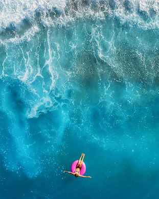 aerial-view-of-young-woman-swimming-on-t