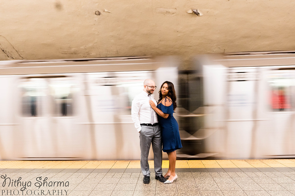 Couple standing in front of NYC subway