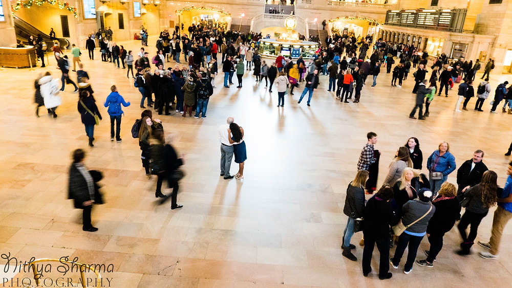 Panorama of Grand Central Station with couple embracing