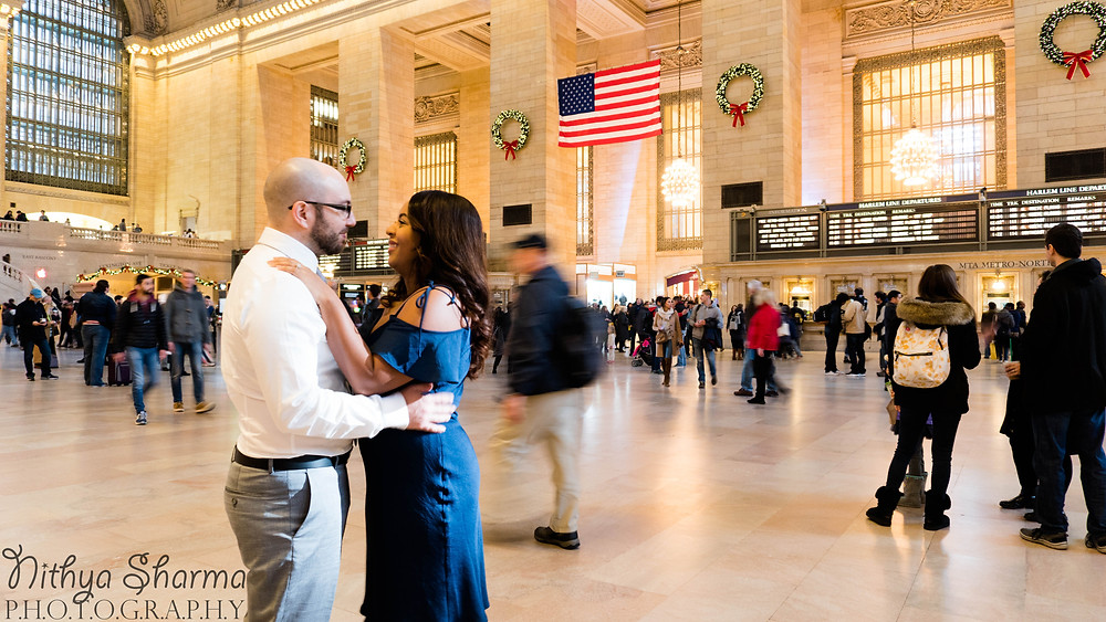 Couple embracing in Grand Central Station