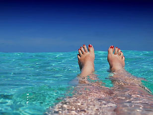toes out the water - red nails.jpg