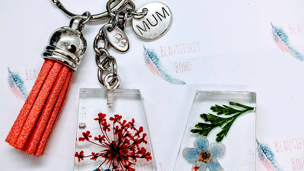 Beautiful handmade real flower resin initial/letter keychain with charms.