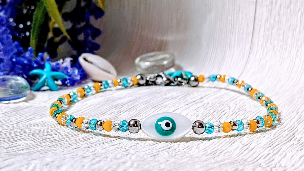 Yellow, turquoise & stainless steel glass beaded anklet with evil eye charm.