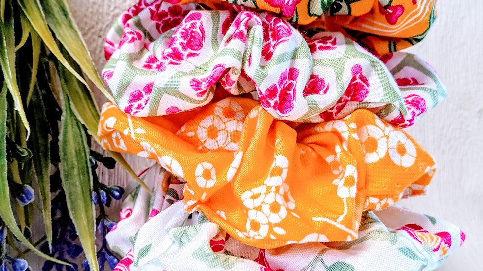 Set of 5 handmade patterned hair scrunchies.