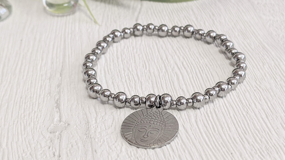 Beautiful stainless steel beaded stretch bracelet with Buddha head charm.