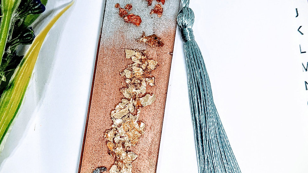 Hand crafted gold, silver & bronze shimmer resin book mark.