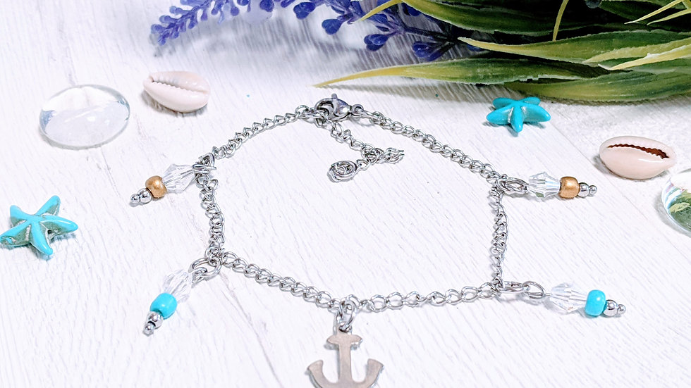 Stainless steel anklet with anchor & seed bead charms.