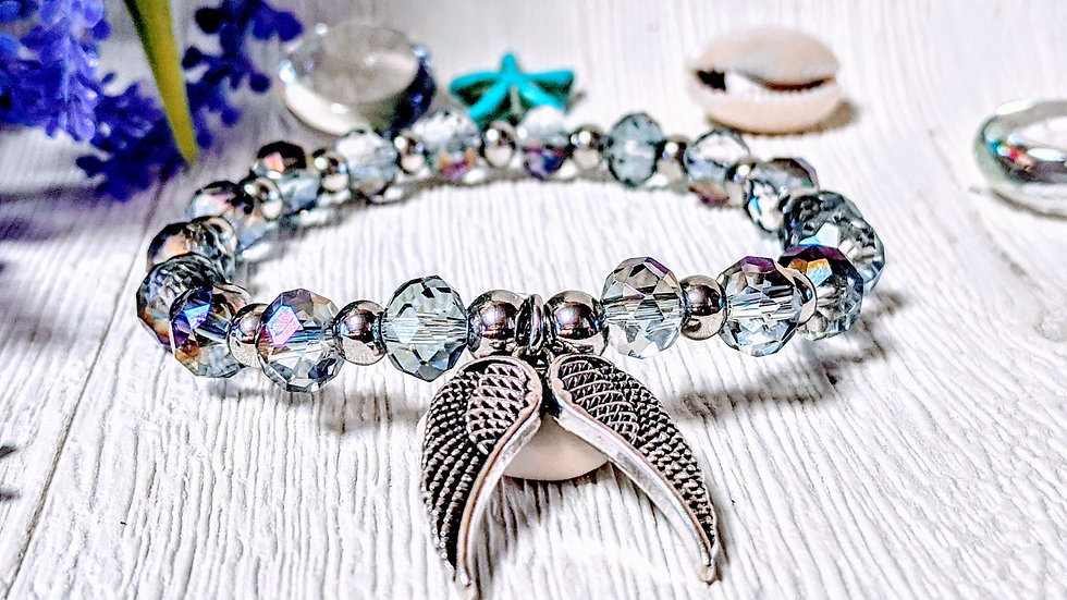 Stunning silver coloured electroplated beaded bracelet with double wing charm.