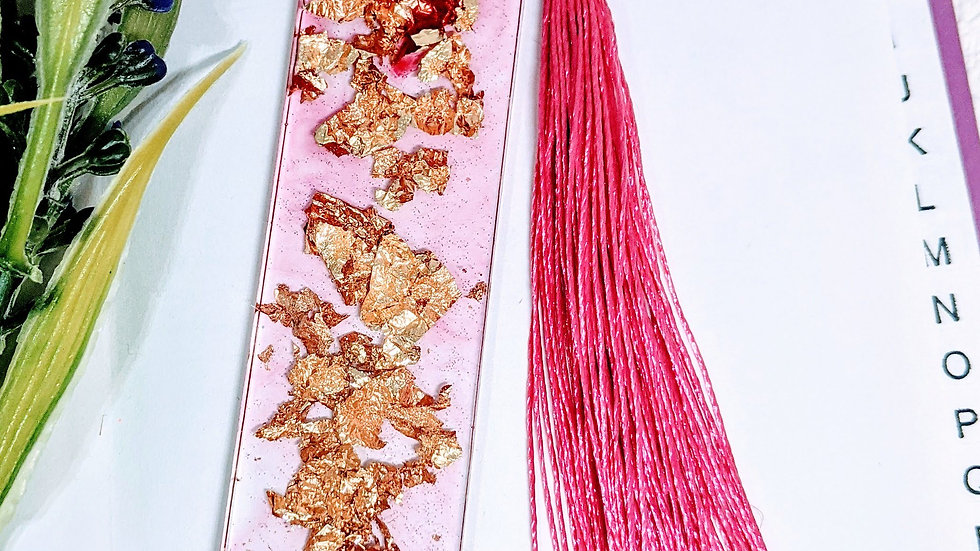 Hand crafted Fuchsia Pink resin book mark with golden foil flakes.