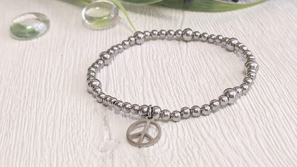 Beautiful stainless steel beaded stretch bracelet with peace charm.