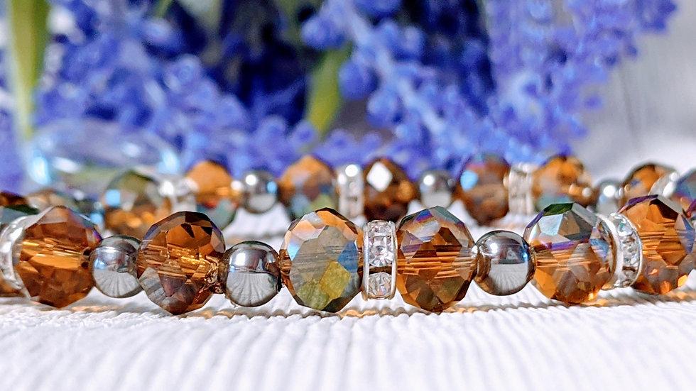 Beautiful dark amber coloured electroplated beaded stretch bracelet.