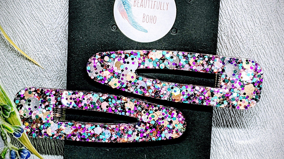 Pair of limited edition Purple Cosmos glitter resin angled hair clip