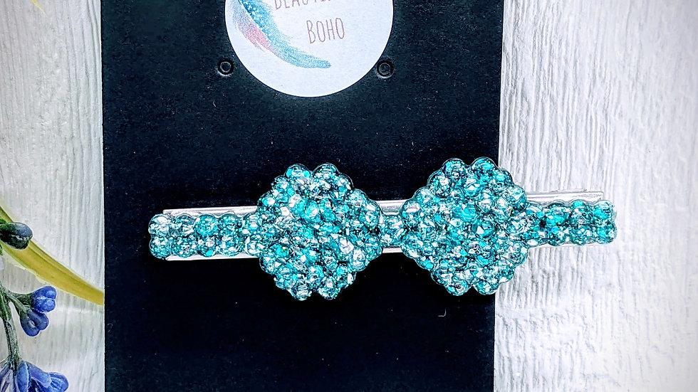 Various coloured glitter resin bow hair clip