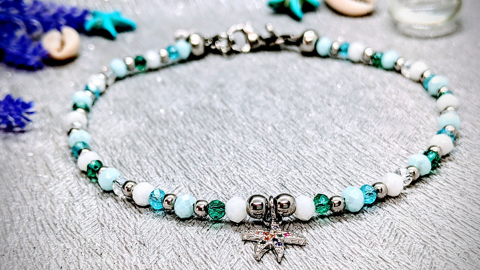 Beautiful handmade anklet. Created with blue, white glass beads & starfish charm