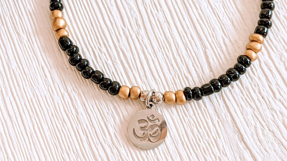 Black & gold seed beaded anklet with stainless steel Ohm charm