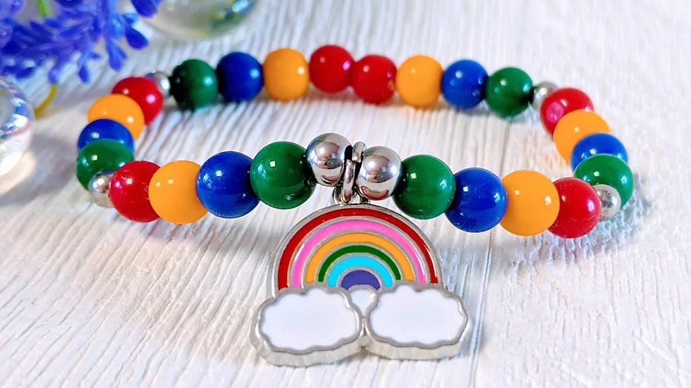 Rainbow beaded stretch bracelet with rainbow charm.