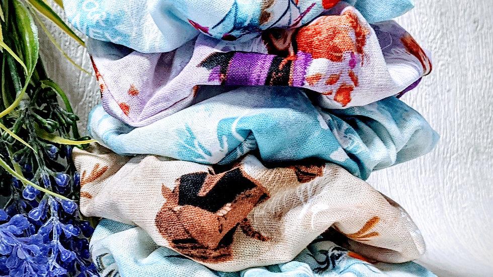Set of 5 handmade Frozen themed cotton hair scrunchies.