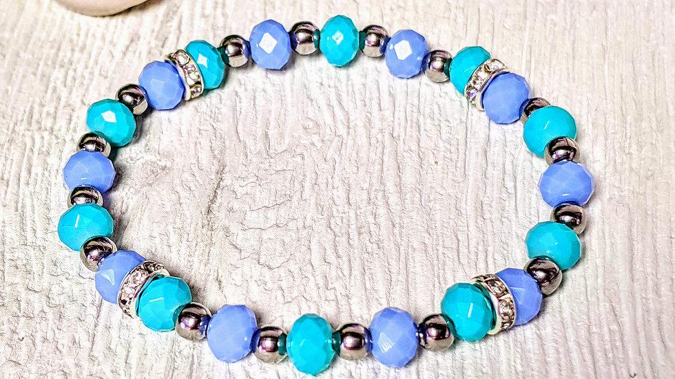 Beautiful lilac & turquoise beaded stretch bracelet.