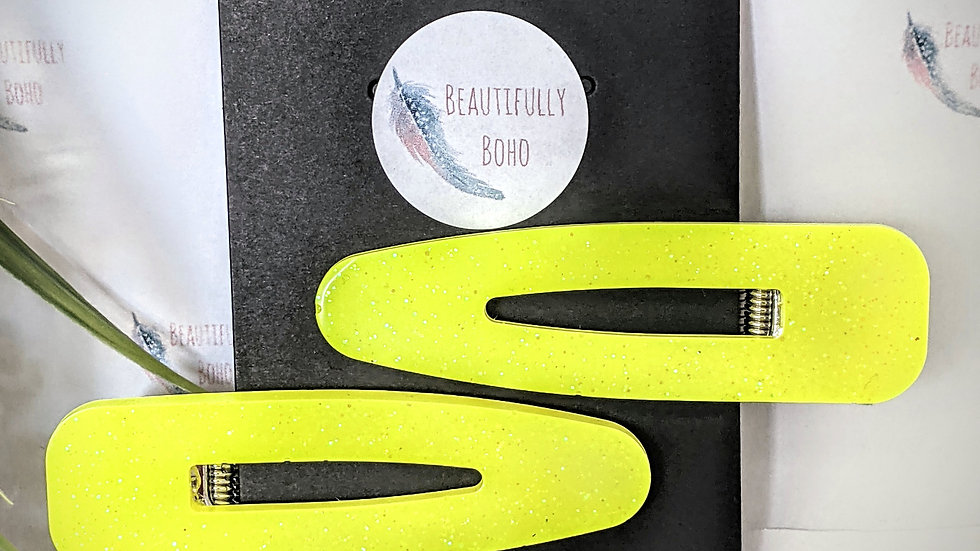 Pair of subtle glitter neon yellow resin hair clips