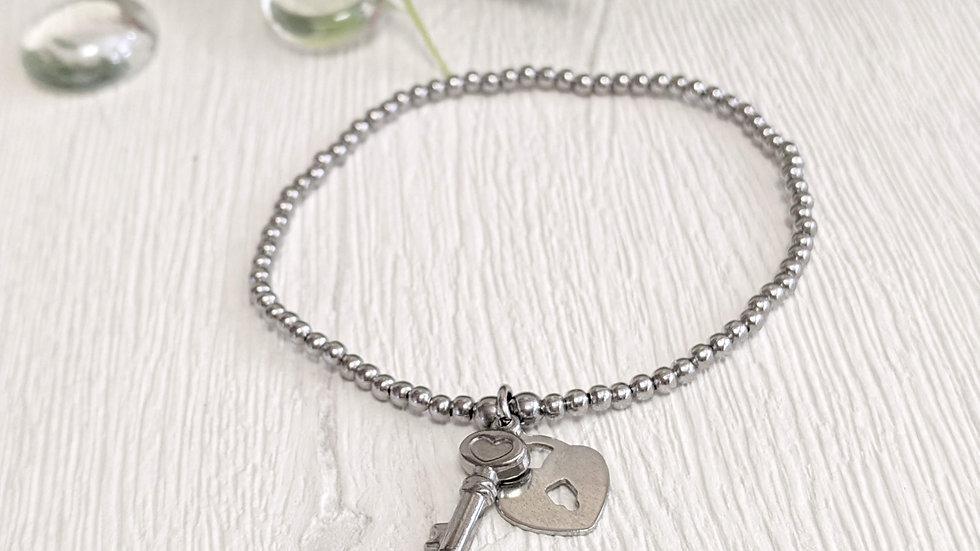 Pretty stainless steel beaded stretch bracelet with lock & key charm.