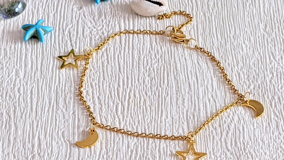 Golden stainless steel anklet with moon & star charms.