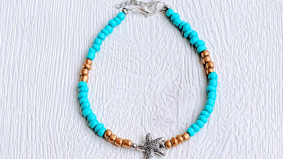 Turquoise & gold seed beaded anklet with Tibetan style silver starfish charm.
