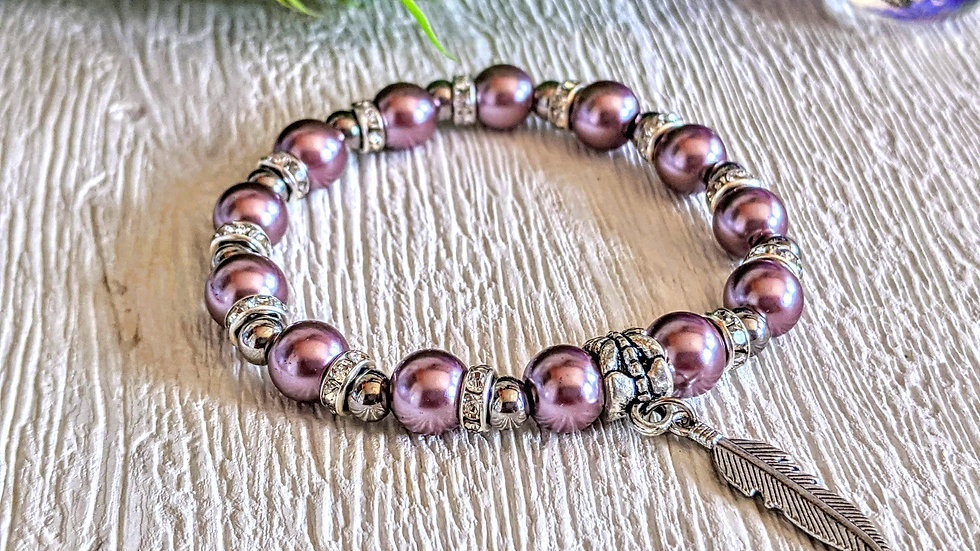 Gorgeous plum pearl, stainless steel & diamante stretch bracelet & feather charm