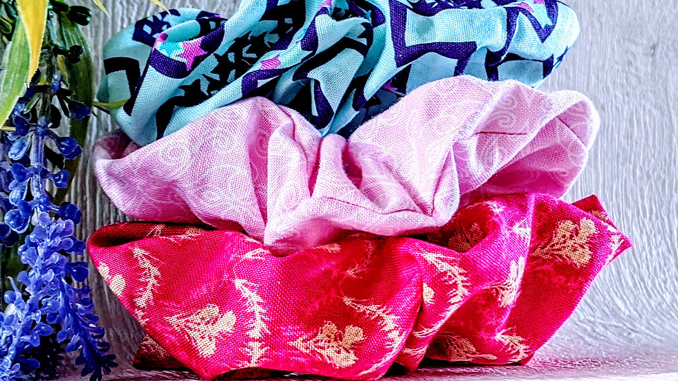 Triple set of handmade patterned cotton hair scrunchies.