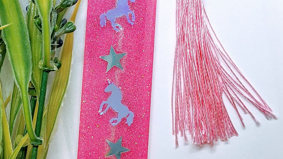 Hand crafted pink shimmer glitter resin book mark.