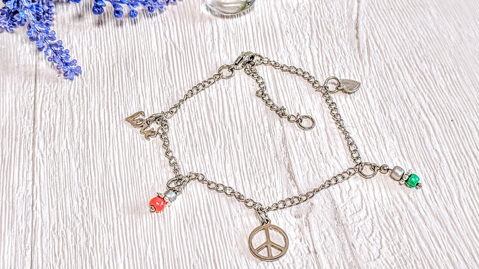 Stainless steel anklet with peace, love, heart & seed bead charms.