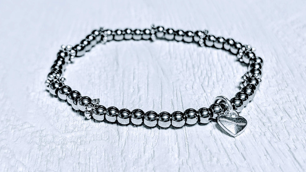 Beautiful stainless steel beaded stretch bracelet with solid heart charm.