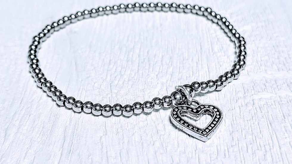 Beautiful stainless steel beaded stretch bracelet with heart charm.