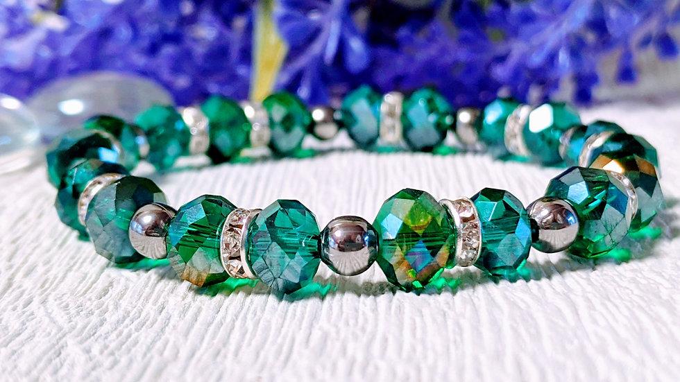 Beautiful Emerald Green electroplated beaded stretch bracelet.