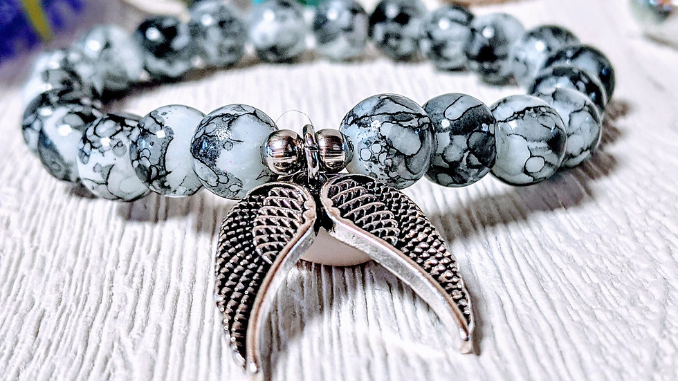 Gorgeous grey & white marbled glass beaded stretch bracelet & double wing charm.