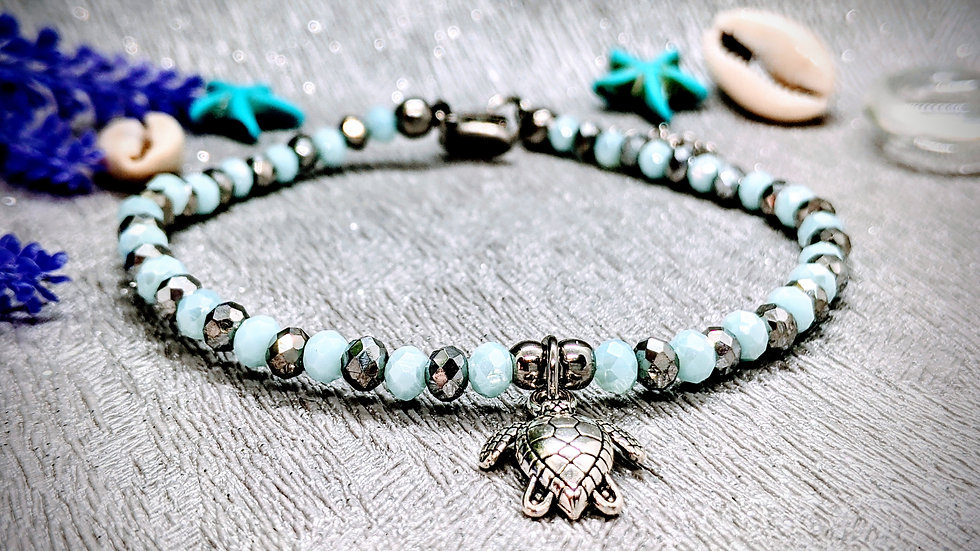 Stunning powder blue & silver beaded anklet with turtle charm.