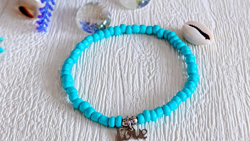 Pretty blue seed beaded stretch bracelet with love charm