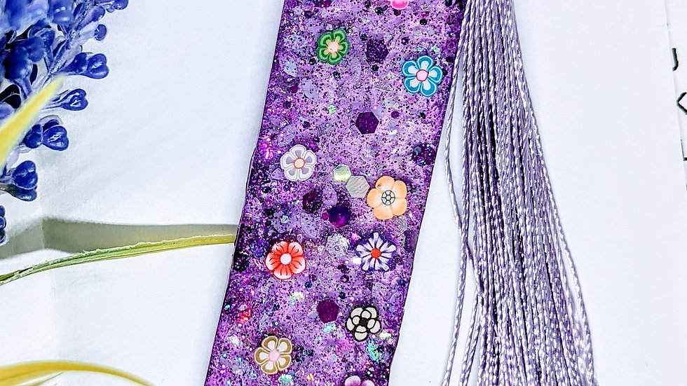 Hand crafted various coloured glitter & floral resin book mark.