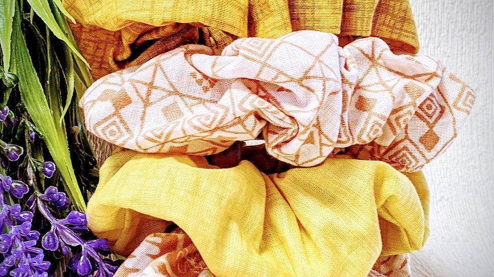 Set of 4 handmade mustard yellow & cream patterned cotton hair scrunchies.