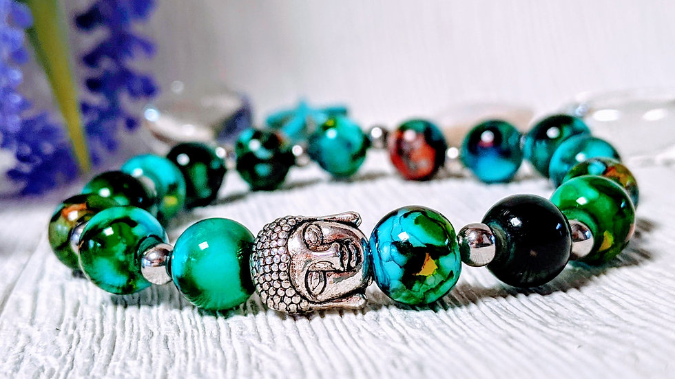 Gorgeous harlequin coloured glass beaded stretch bracelet & Buddha Head charm.