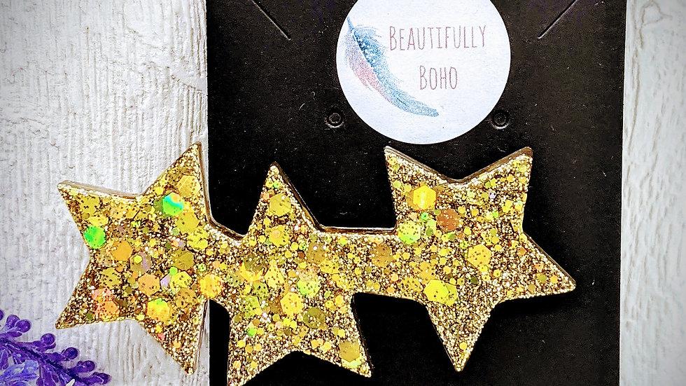 Various coloured glitter resin star hair clip