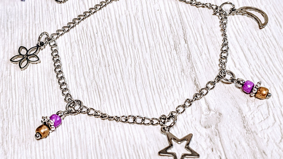 Stainless steel anklet with moon, flower & moon charms.